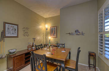 Adjacent to kitchen is cozy breakfast nook with seating for 4 and serving buffet
