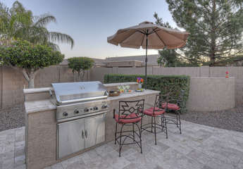 Built-in gas grill and bar seating will please the outdoor chef