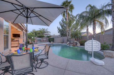 Secluded resort-style backyard will be everyone's favorite place to relax or play