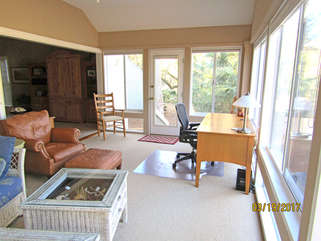 Sit at the desk in the sunroom to enjoy the view while catching up on your work!