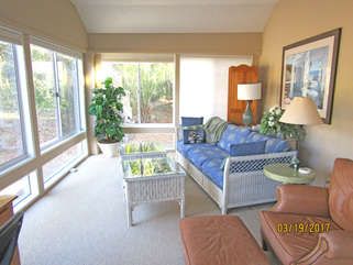 The enclosed sunroom is wonderful room to relax in and enjoy the scenery!