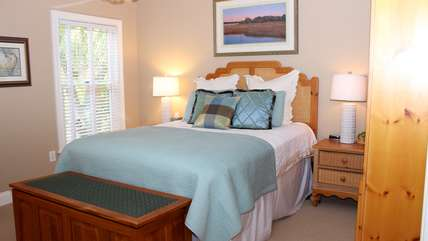 The master bedroom has a queen size bed.