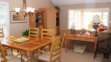 A spacious dining and living room greet you as you enter.