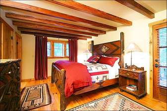 Master Bedroom Boasts a King Bed and Private Bath