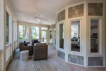Screened in luxury seating directly off the kitchen  helps you extend your memorable days on Seabrook Island while taking in the breeze and golf course view.