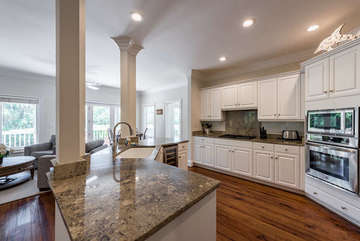 Granite counter tops, high end appliances accentuate this well stocked kitchen with wine cooler too!.