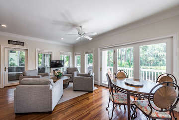 Large open kitchen affords several seating areas overlooking the deck and golf course.
