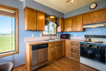 Spacious, well equipped and colorful kitchen.