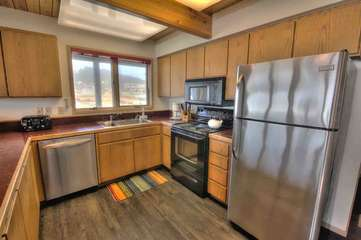 Stainless steel appliances and fine cabinetry.