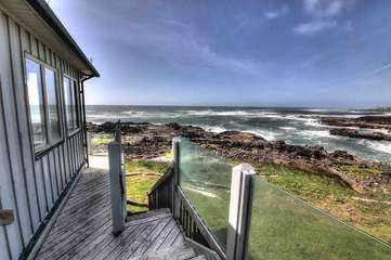 Walk onto the rocks and explore the tidepools right in front of the house.