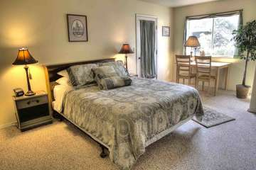 The two downstairs bedrooms feature queen beds and private bathrooms.