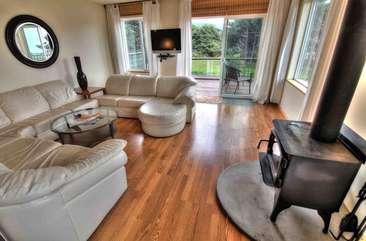 Beautiful hardwood flooring and modern furnishings.