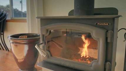 Wood burning stove provides warmth and charm.