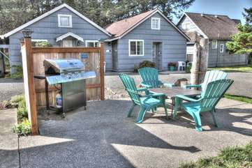 Shared outdoor seating and gas grill.