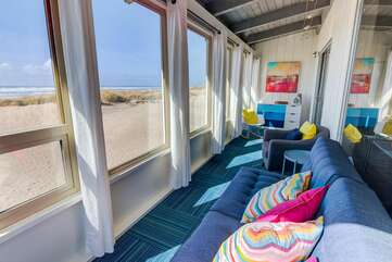 Upstairs sunroom with full-size sleeper futon and ocean views.