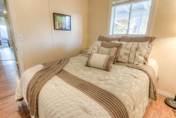 Two bedrooms with queen beds and hardwood flooring.