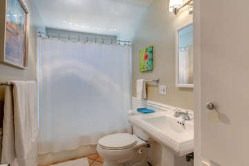 Full bathroom with a tub/shower for the kids