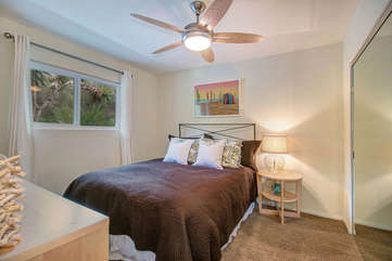 Lovely bedroom with Queen bed, a flat screen TV, and closet space.