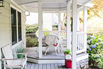 The covered eating area on the front porch