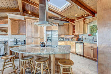 Remodeled Kitchen with skylight and bar seating