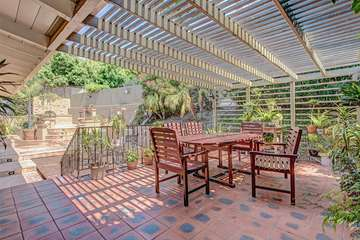 Spacious outdoor dinning on upper patio