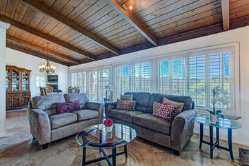 Vaulted ceilings, wood beams, skylights, and an ocean view.