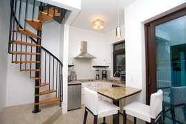 Breakfast bar and stairs to the bedroom