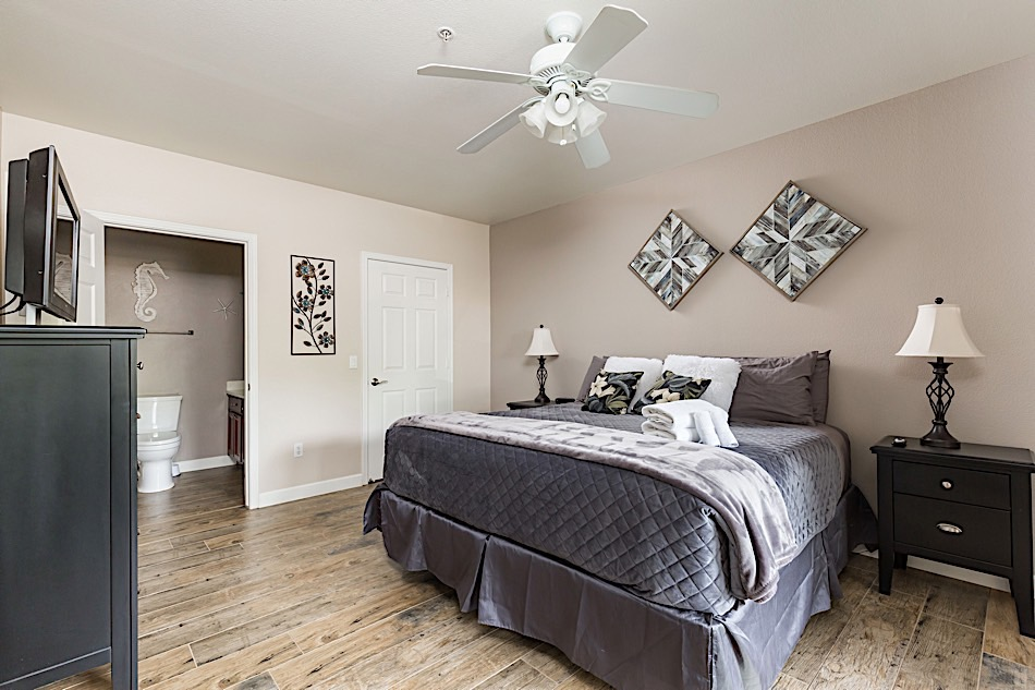 Master bedroom - King sized bed, flat screen TV,  attached bathroom and walk-in closet