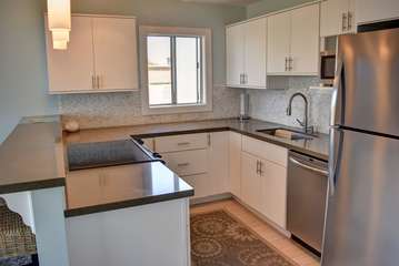 Upgraded kitchen with stainless steel appliances and stone counters