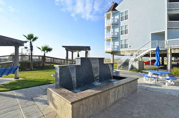 Fountain and feet washing area, at beach access and pool entrance