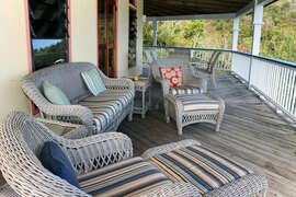 Lounge area on covered patio overlooking Coral Bay