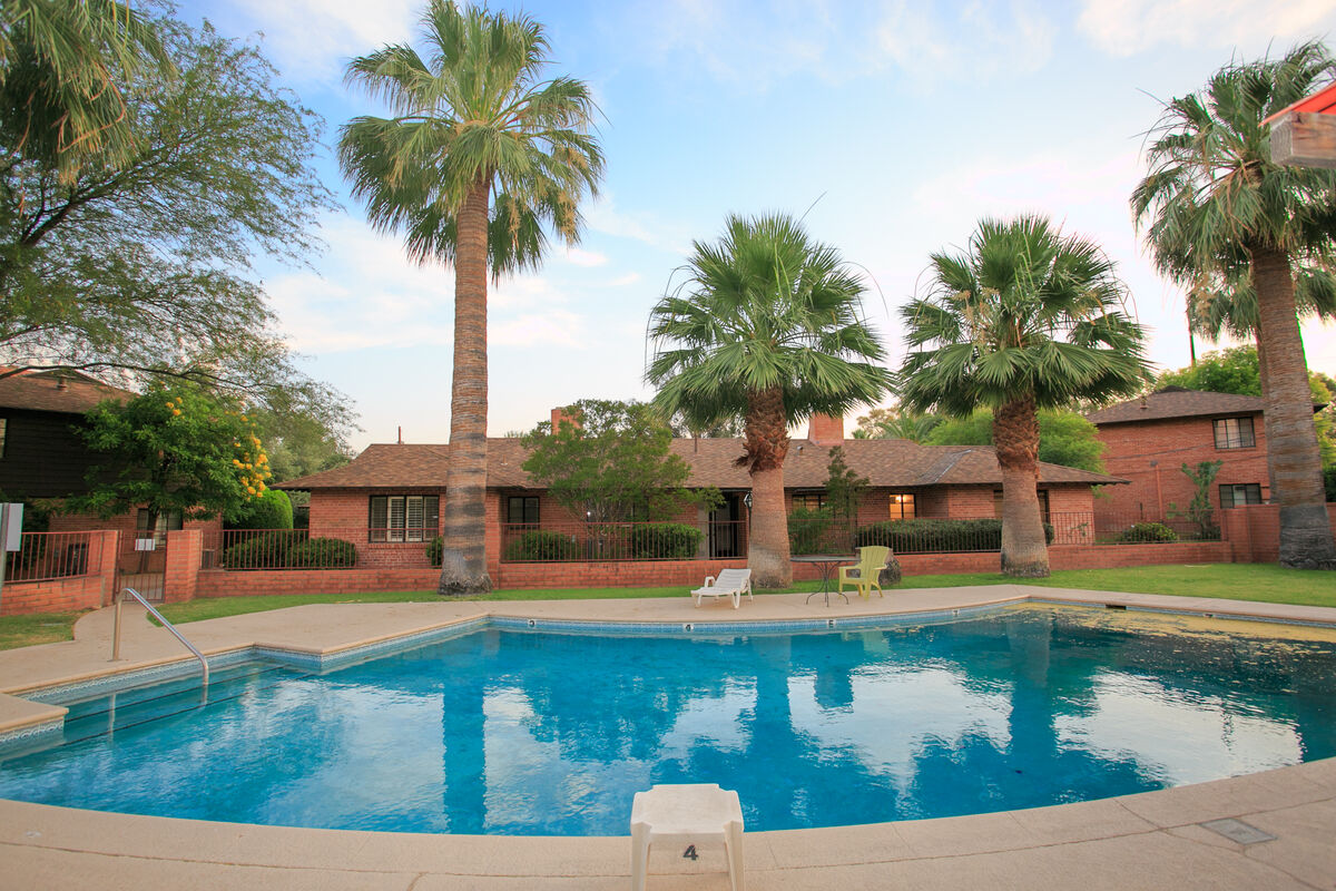 The community pool is well kept, with outdoor ramada and BBQ area