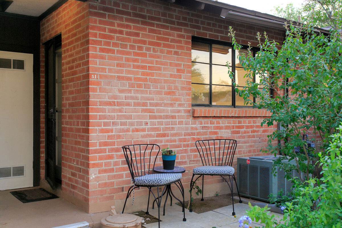 The back patio is right by the pool and offers a perfect and private space to relax while still enjoying the outdoor pool area!