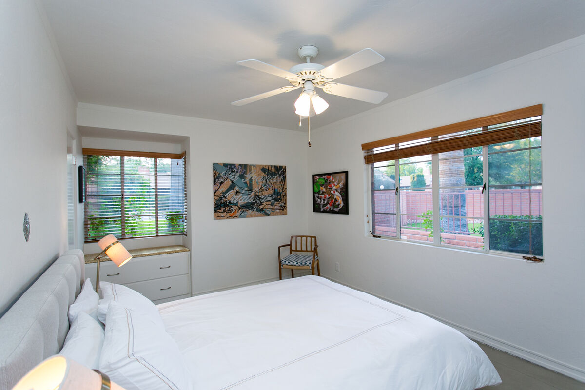 The Second Bedroom features a large Queen bed and luxurious bedding