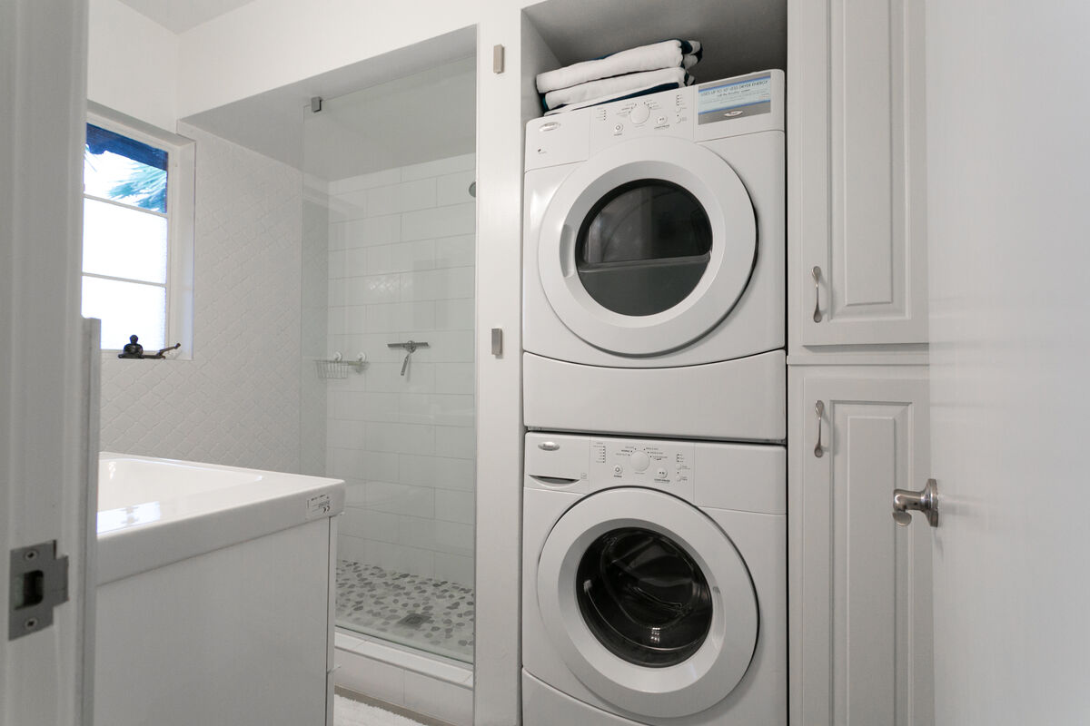 Modern stackable washer and dryer are conveniently located in the bathroom.