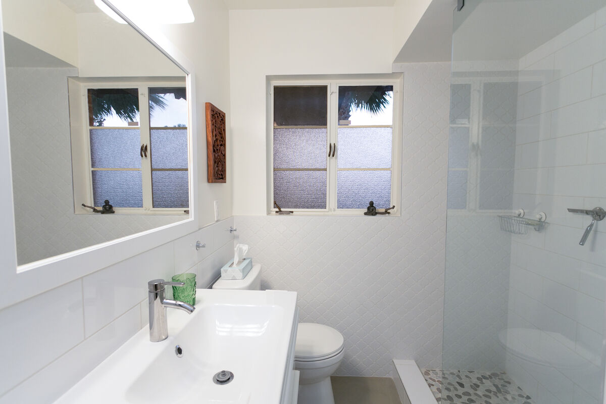 The bathroom has been upgraded and modernized with a bright and cheerful feel