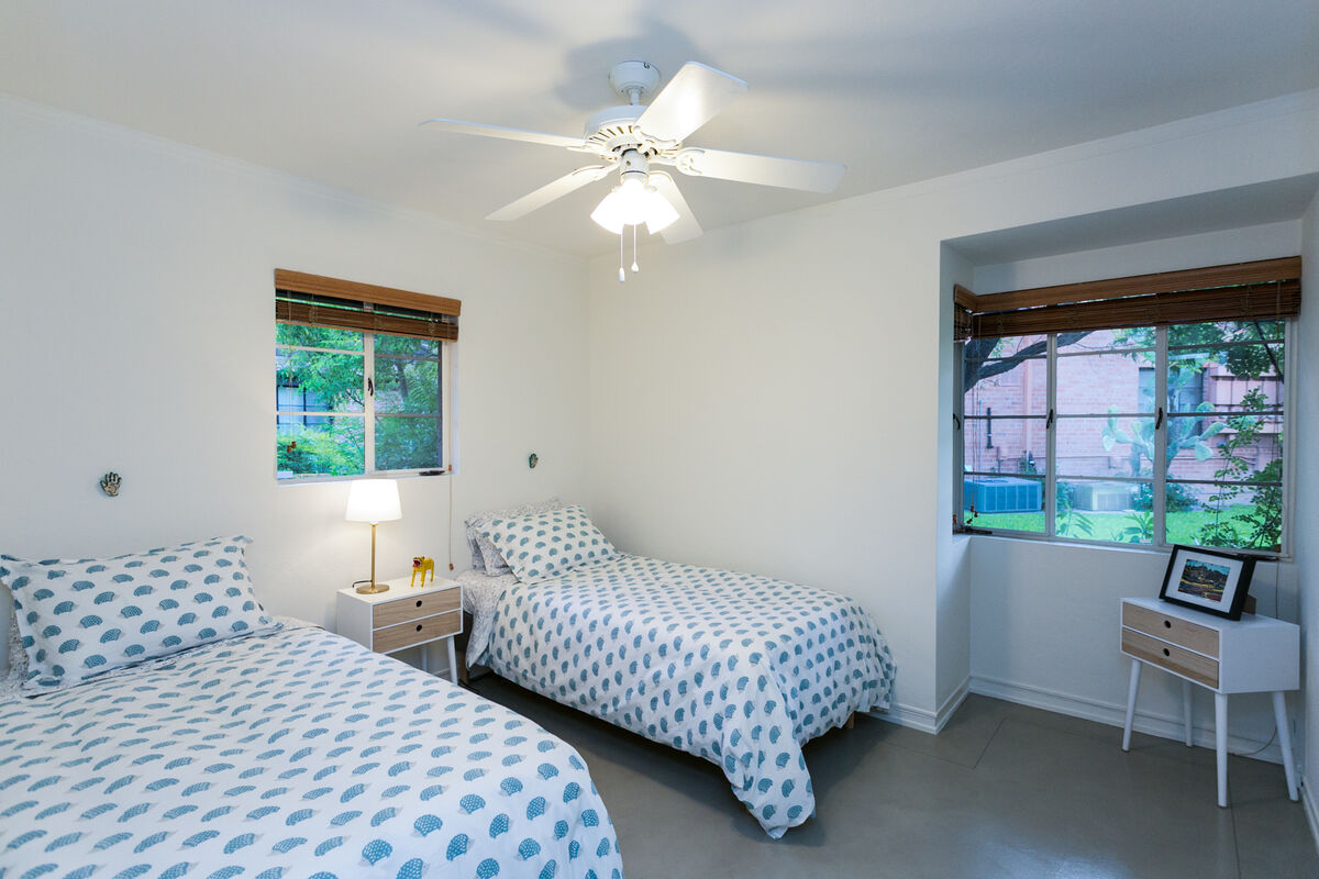 The first bedroom features relaxing colors and the two twin beds can be converted to a King