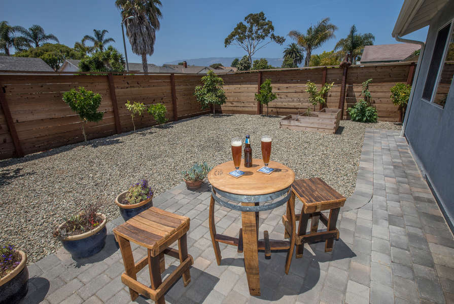 Enjoy refreshments and a view in the enclosed front yard