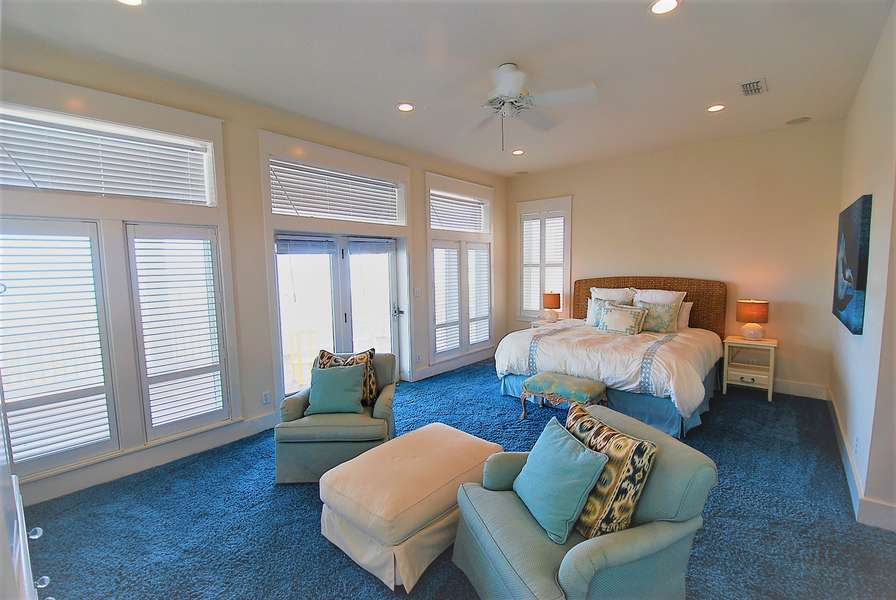 Master Bedroom with windows overlooking private balcony to beach