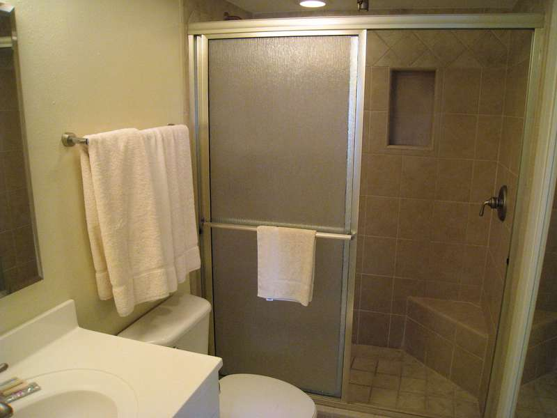 Master bathroom; Walk in shower with shelf/ stool