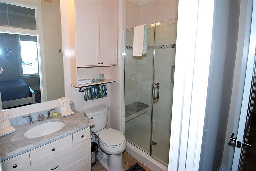 Second Bathroom with stand up tiled shower.