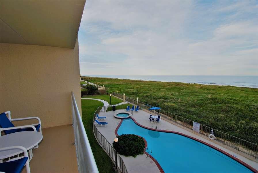 Beachfront balcony facing the pool and beach