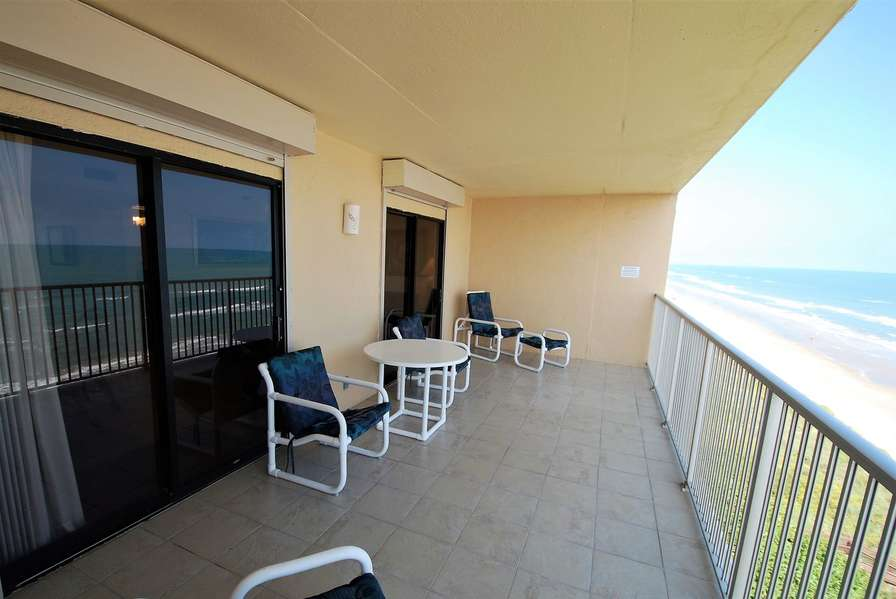 Private balcony with comfortable lounge chairs and table