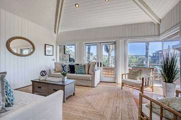 Beach themed vaulted living room with ocean views