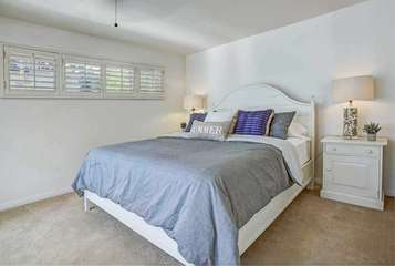 Downstairs bedroom with king bed and daybed