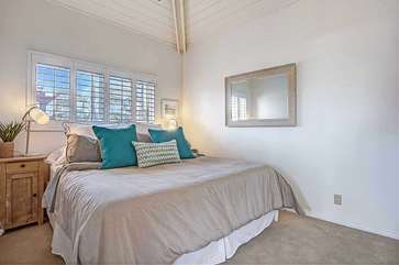 Upstairs vaulted ceiling bedroom with Queen bed