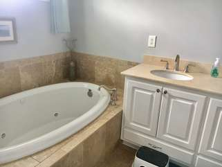 Master bathroom has double sinks.