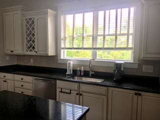 Large window above the kitchen sink.