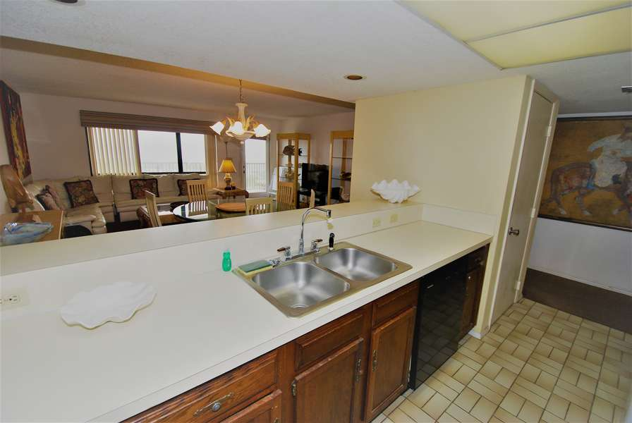 Kitchen view looking into dining/living room