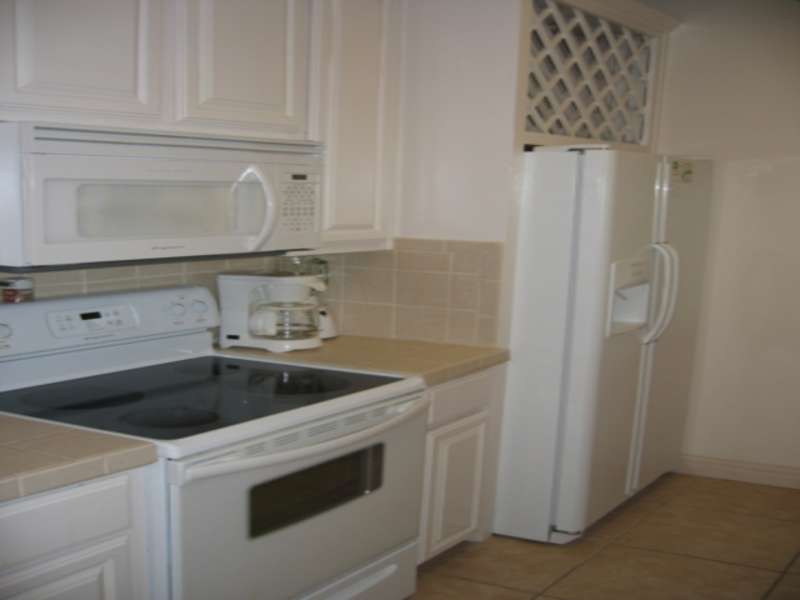 Glass Cooktop, Coffee maker, Microwave, Fridge. Cabinet space for your items